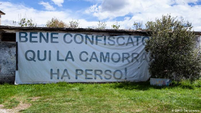 A sign reading Seized property, here Camorra hast lost outside a dairy farm in Campania